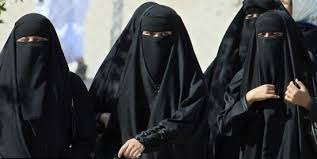 Muslim Women Sweltering in Burkas